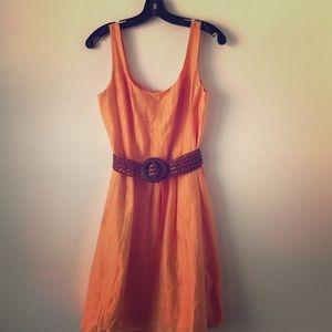 Cute orange dress w woven belt.